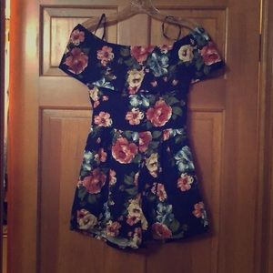 Cute navy romper with floral print